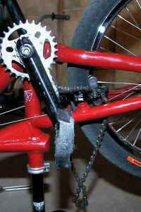 chain_removed_from_rear_sprocket_and_hanging.jpg (42676 bytes)